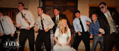 Boys dancing around bride