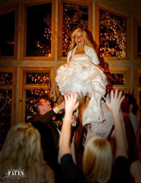 Bride being lifted in the air