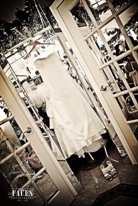 Wedding dress and shoes hanging up