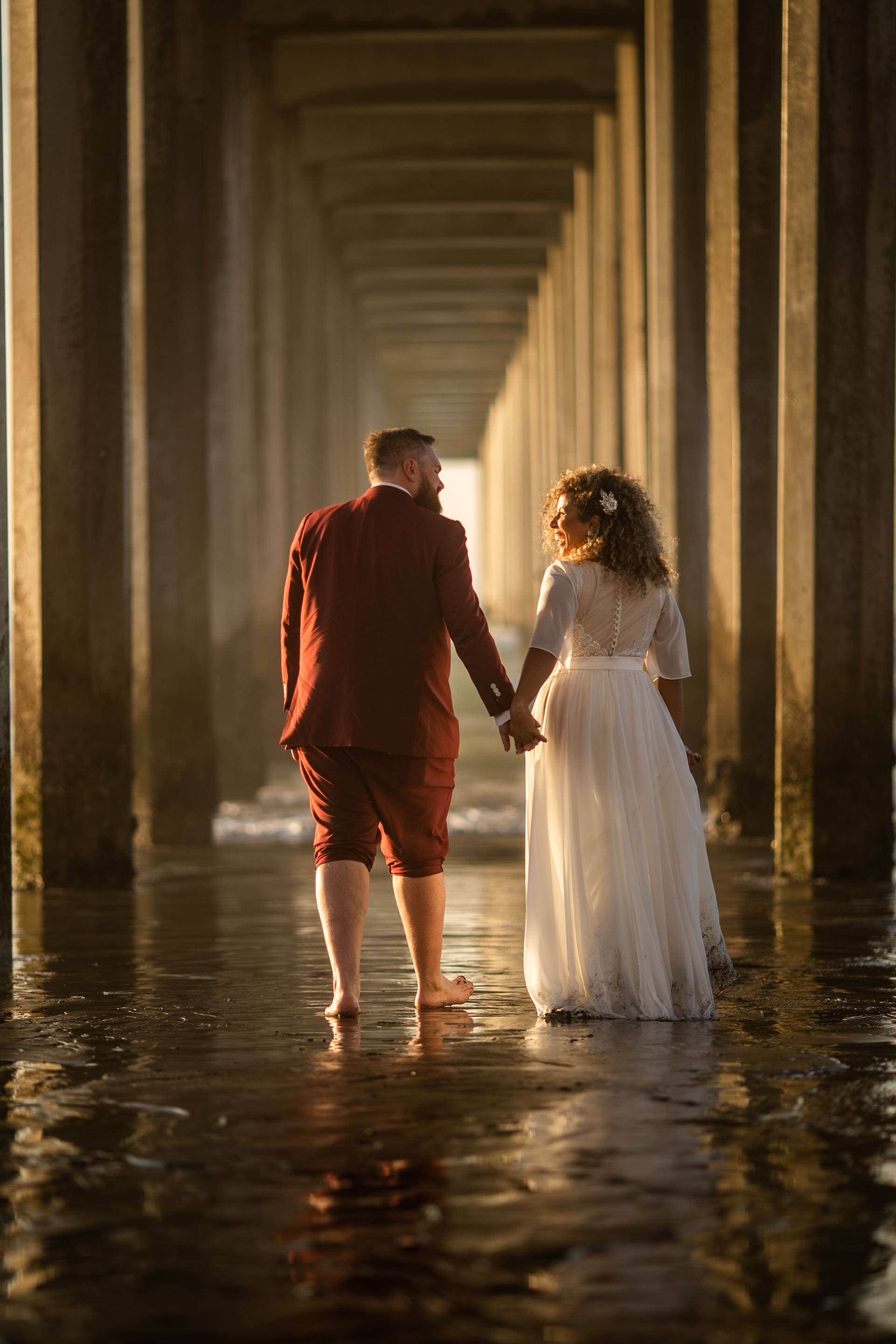 Gerusa Eric Under Scripps Pier Beach Wedding Faces Photography