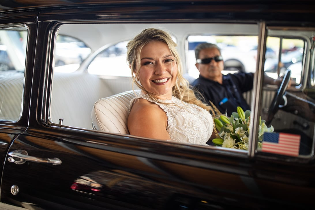 Bride driving to ceremony in a Belair