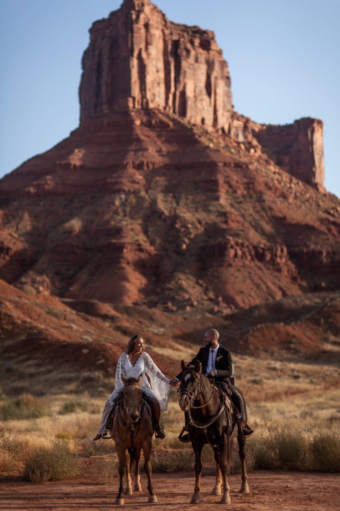 Horseback Riding during their moab eleopement