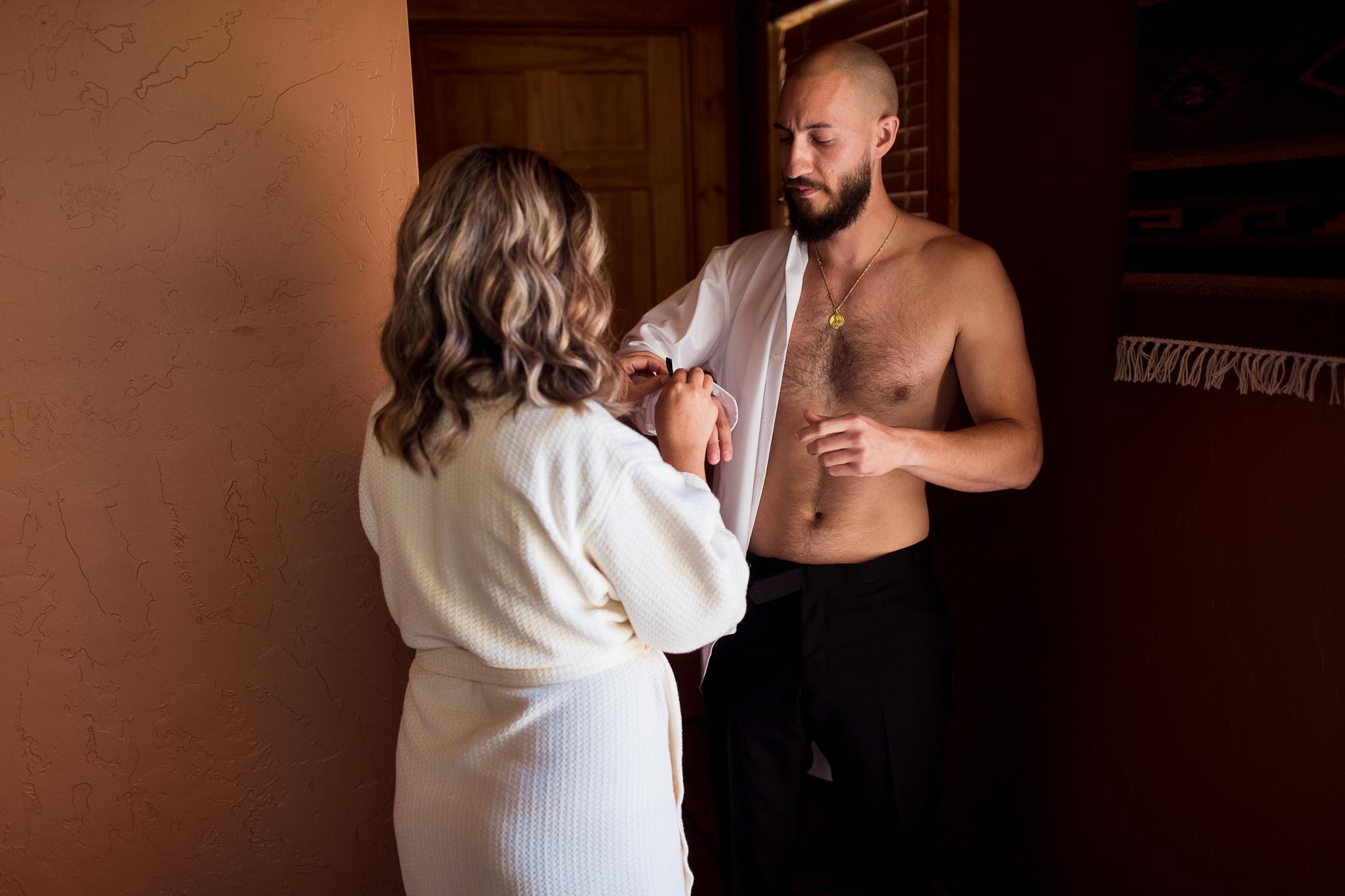Bride and Groom getting ready in Moab Utah