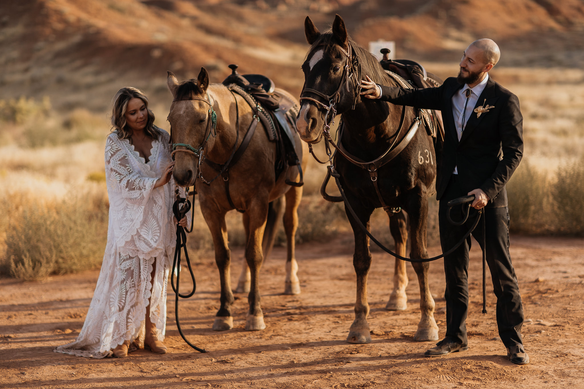 Bride and Groom Horseback Ride near Castleton Tower