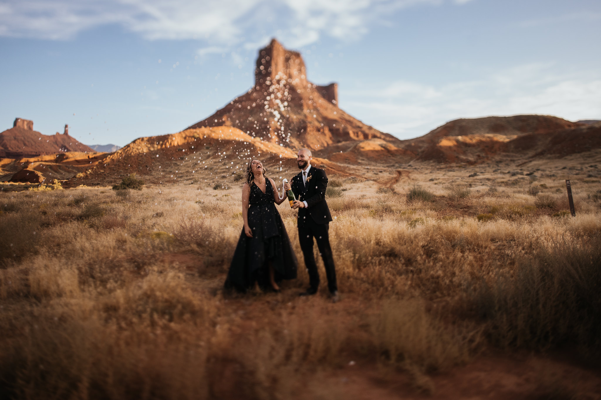 Bride and Groom Celebrate their Moab Elopement with Champagne Toast