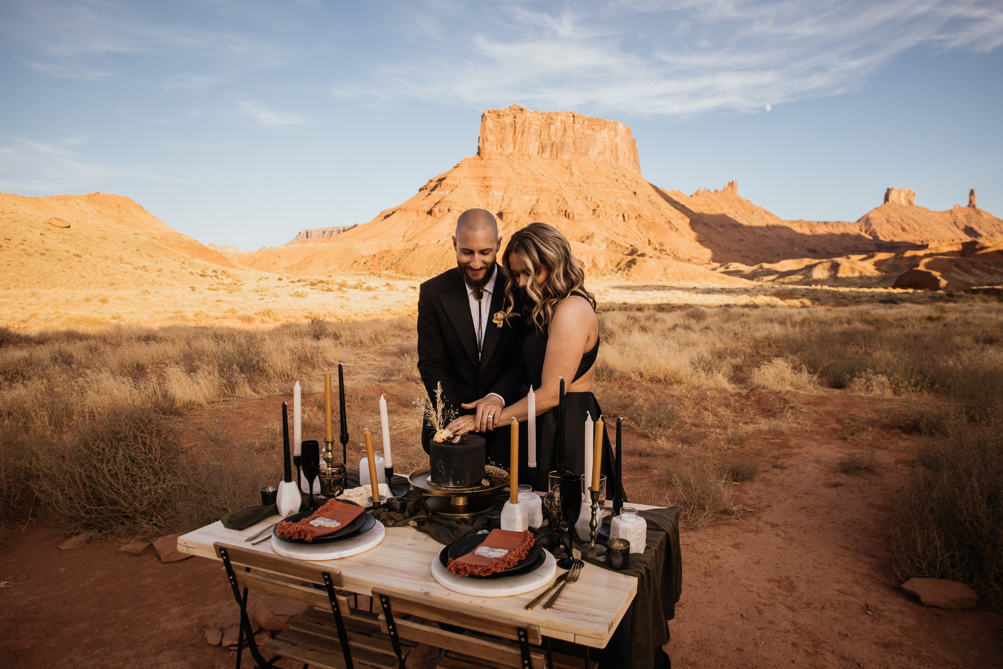 Bride and Groom Cut the Cake in Moab Utah