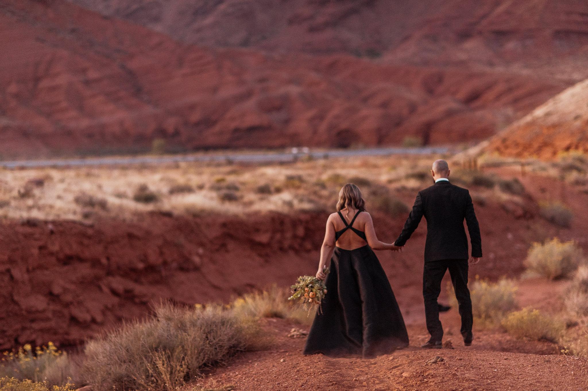 Bride and Groom Take Formal Portraits in Moab Utah