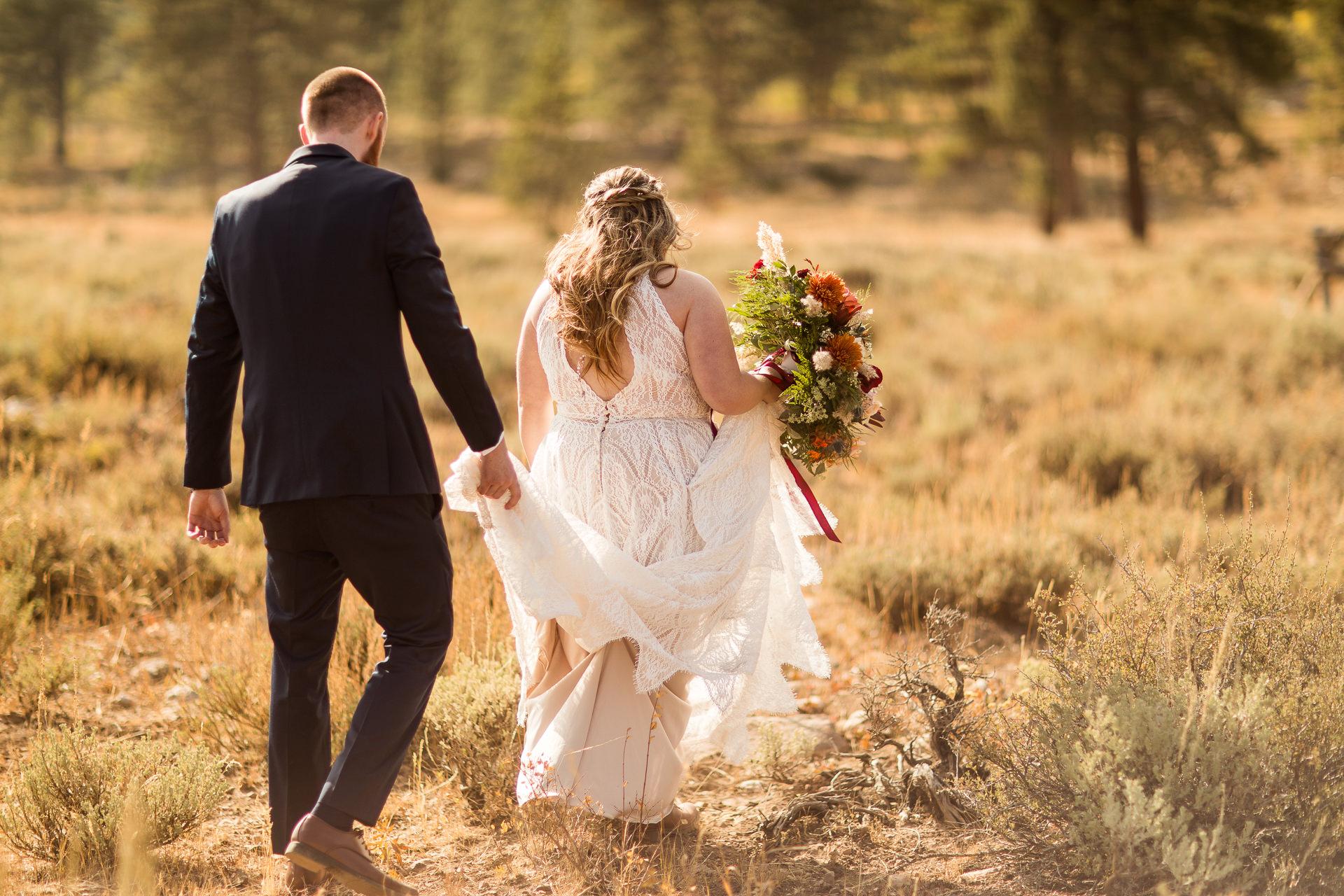 Groom Carries Bride's Dress