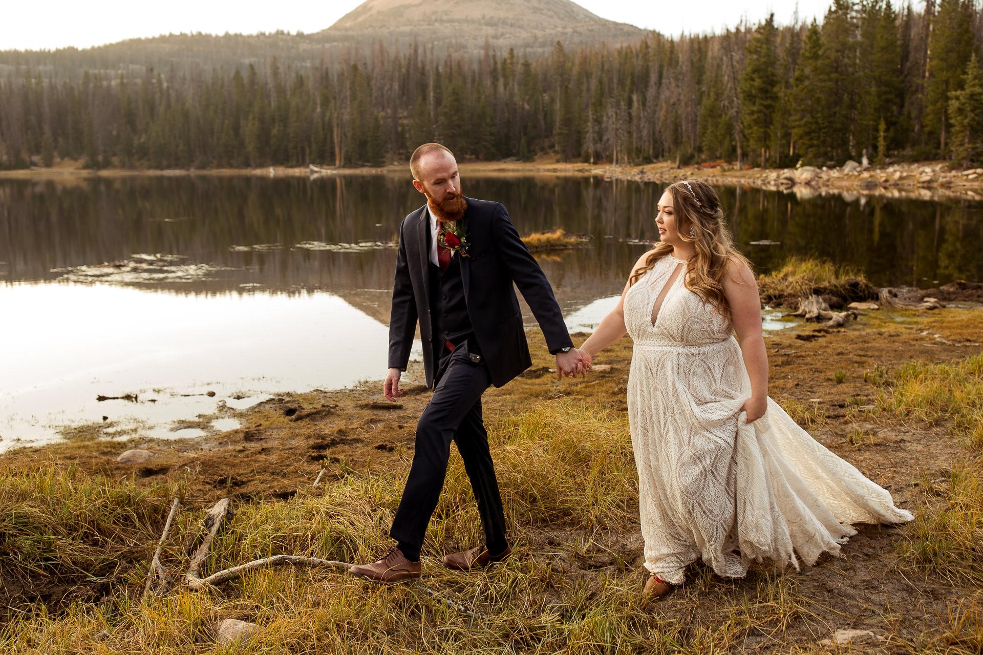 Wedding Couple Walks Lakeside