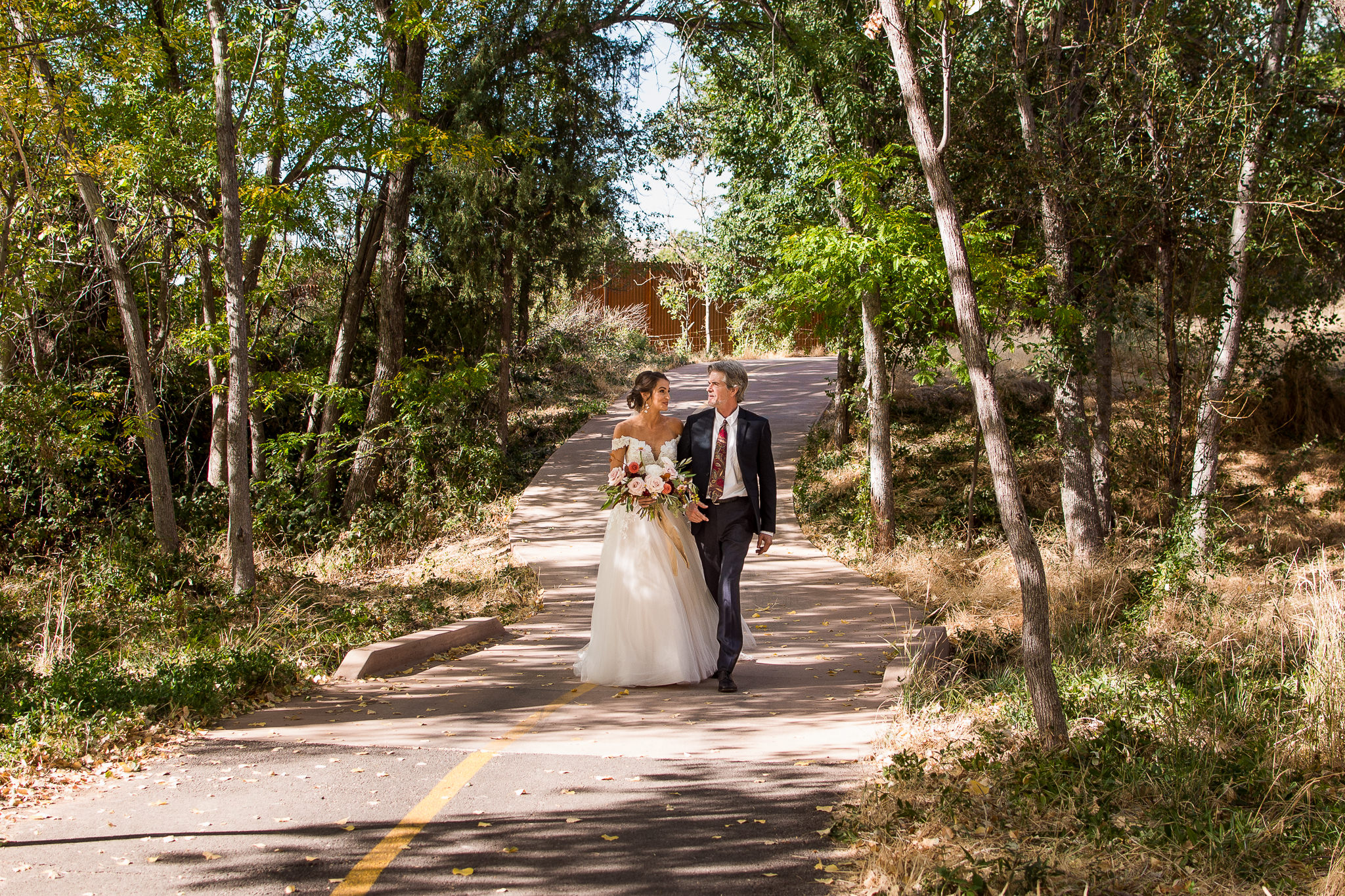 Bride and Dad Walking to Ceremony