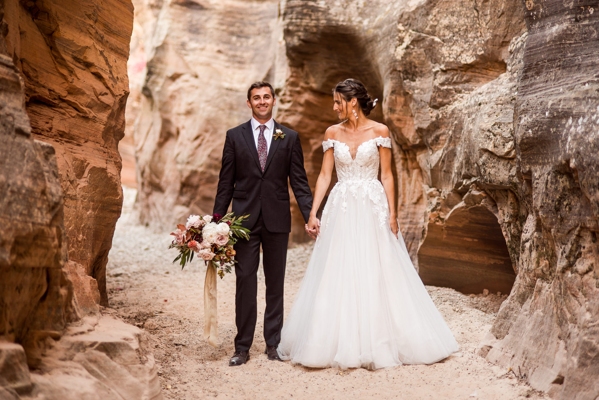 Bride and Groom take Portraits in a slot Canyon